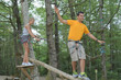 young man and woman having fun in the trees