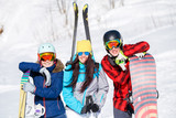 Photo of sports women and men with snowboard on vacation - 209188945