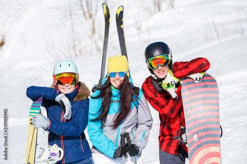 Leinwanddruck Bild Photo of sports women and men with snowboard on vacation