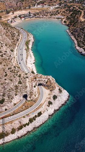 Fotobehang Groen blauw Aerial drone bird's eye view photo of Tunnel in Athens riviera seaside road known as hole of Karamanlis, Attica, Greece
