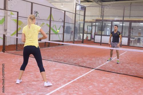 Fototapeta people woman and man playing tennis