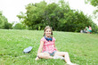Girl having fun in the park with her skate