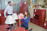Couple in store looking at lamp - 209193393