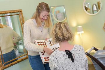 salon client selecting a hair shade