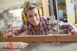 Leinwanddruck Bild - smiling female carpenter in her workshop