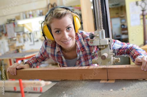 Leinwanddruck Bild smiling female carpenter in her workshop