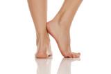 beautifully groomed bare feet on white background