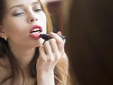 Woman painted pink lips. Beauty lips make-up. Perfect skin, full lips. Retro make up. Professional make-up artist applying sexy lips makeup. Fashion makeup. - 209202965
