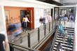 Busy High School Corridor During Recess With Blurred Students And Staff