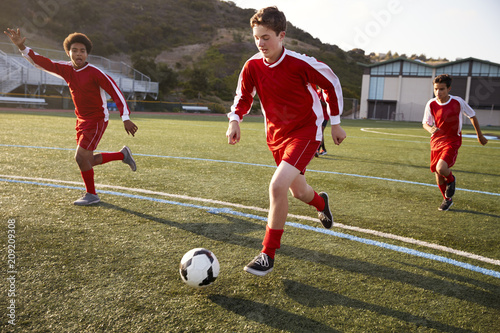 Leinwanddruck Bild Group Of Male High School Students Playing In Soccer Team