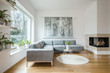 Leinwanddruck Bild - Spacious white living room interior with grey corner couch, big modern art painting and fireplace