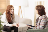 Friendly therapist supporting red-haired woman - 209212396