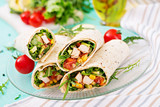 Burritos wraps with chicken and vegetables on light  background. Chicken burrito, mexican food. - 209213350