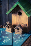 Closeup of cute home for birds in wooden workshop - 209217165