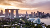 Fototapety Aerial drone view of Singapore city skyline at sunset