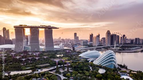 Leinwanddruck Bild Aerial drone view of Singapore city skyline at sunset