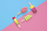 Ice cream popsicles lollipops on blue and pink pastel background for summer.  Wooden ice cream lollies toys - 209219311