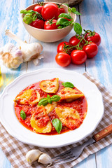 Delicious pasta - ravioli in tomato sauce with basil