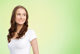 body positive and people concept - happy woman in white t-shirt over lime green natural background - 209229554