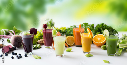 healthy eating, drinks, diet and detox concept - glasses with different fruit or vegetable juices and food on table over green natural background - 209229945