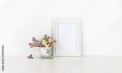 Vertical wooden frame mockup with flowers on white background - 209231764