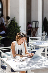 A Woman Freelancer Working at Cafe