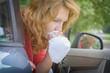 Leinwanddruck Bild - Woman suffering from motion sickness