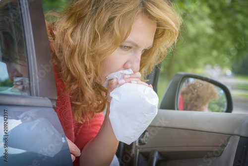 Leinwanddruck Bild Woman suffering from motion sickness
