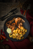 roasted sleeves chicken with potatoes and barbecue sauce - 209243578