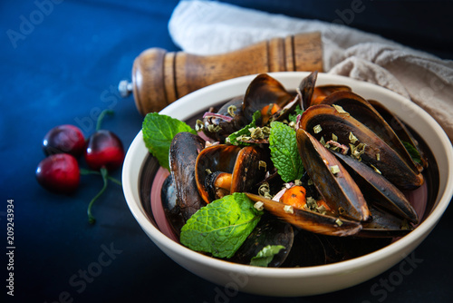 Fototapeta Italian Steamed Mussels cooked in Provencale style