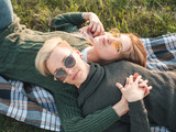 Two women are lying on the grass. Best friends - 209246180