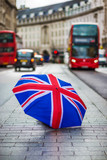 London, England - British umbrella at busy Regent Street with iconic red double-decker buses and black taxi on the move - 209249188