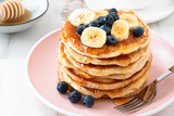 Homemade pancakes with blackberries and banana - 209251106