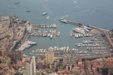 Scenic panorama of Monaco from the observation deck. Roofs of houses and buildings and hills on background. Sailing boats and yacht harbour, port. Aerial top view, foggy morning. France - 209252154