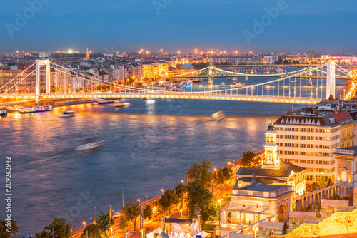 Aerial cityscape view with illuminated Elisabeth bridge during the twilight in Budapest, Hungary