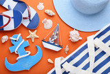 Beach accessories with seashells on orange background - 209268129