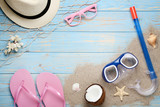 Beach accessories with coconut and diving mask on wooden table - 209268185