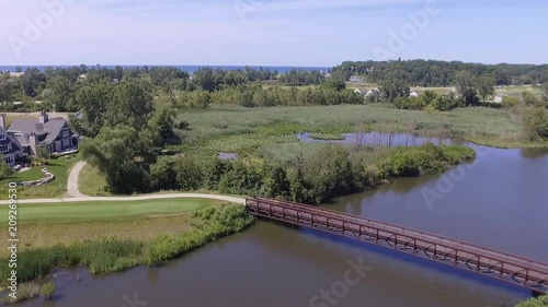 Drone shot over Golf Courses towards Lake Michigan. Full-HD.