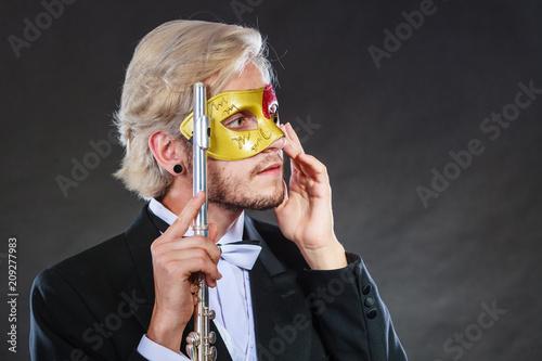 Fotobehang Muziek man in carnival mask playing flute