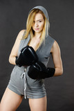 Boxer girl exercise with boxing gloves. - 209278185