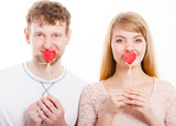 Lovely couple covering their mouth by heart. - 209278381