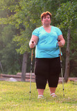 Overweight woman walking on forest trail. Slimming and active lifestyle theme.  - 209282732