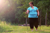 Overweight woman walking on forest trail. Slimming and active lifestyle theme.  - 209282765