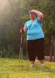 Overweight woman walking on forest trail. Slimming and active lifestyle theme.  - 209282784