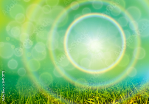 Green grass background with bokeh and rainbow