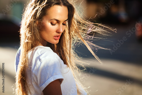 Beautiful woman with flying hair