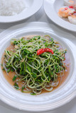 stir fried sunflower sprout with oyster sauce and chili