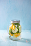 Detox water with vegetables and fruits. Diet healthy eating and weight loss.
