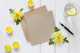 Sheet of kraft paper with a pen on wooden background - 209327199