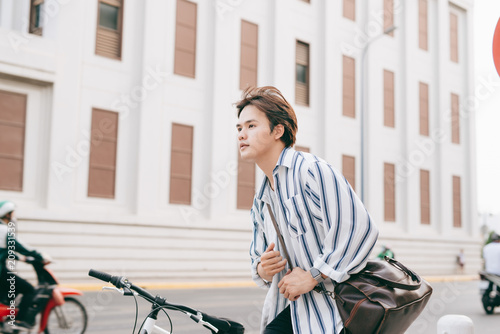 Foto Murales Successful handsome asia man riding bicycle